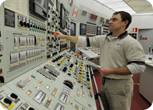 Nuclear facility employee at control panel