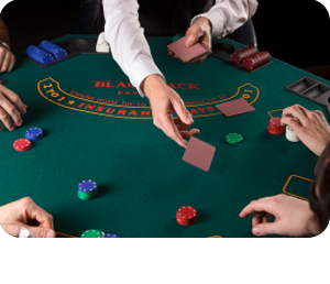 Blackjack dealer at dealing cards at table